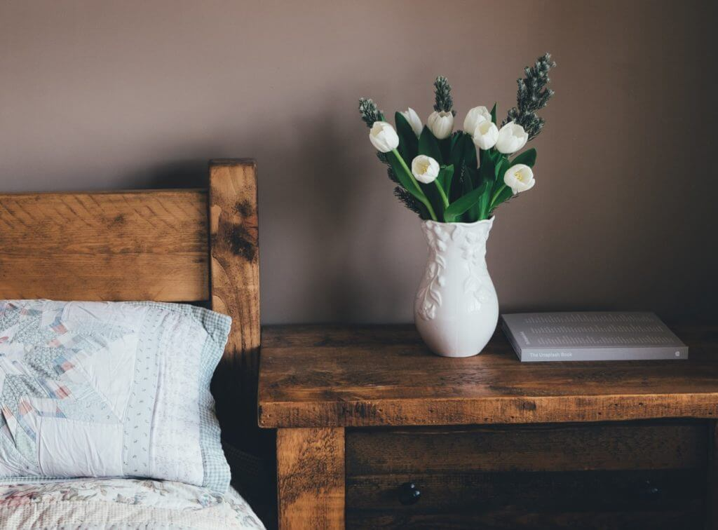 wooden nightstand with flowers